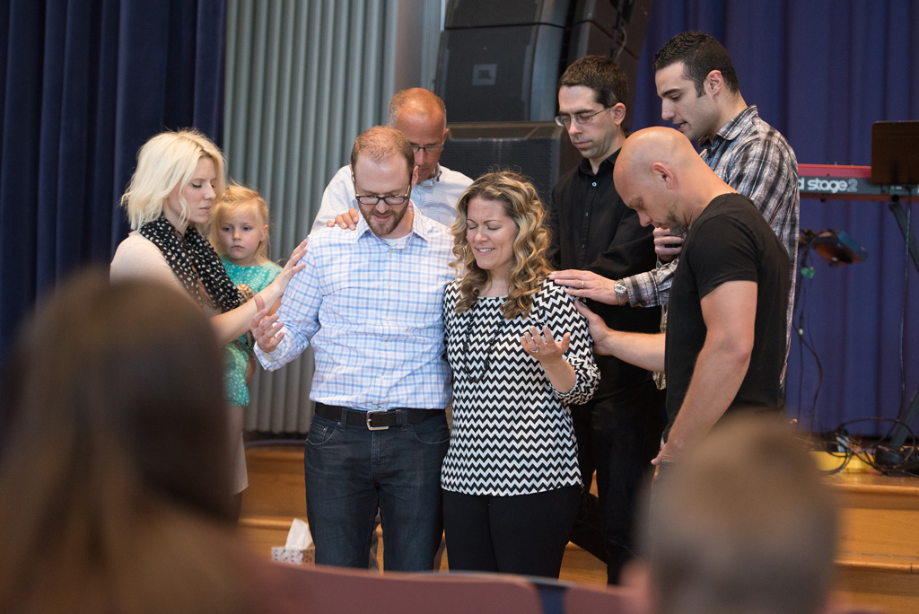 Praying over Peter and Laura Andrews, and commissioning Laura into her new role.